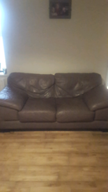 Brown two seater leather sofa.
