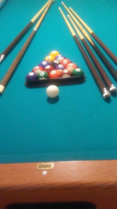 Pool Table. Like brand new! Standard Cooper 8 x 4.