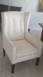 Matching white wing back chairs