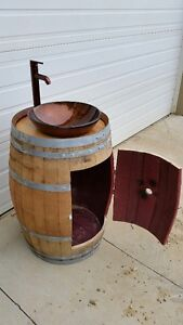 Wine barrel bathroom vanity with vessel sink and faucet