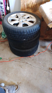 Three Mazda alloy rims & tires