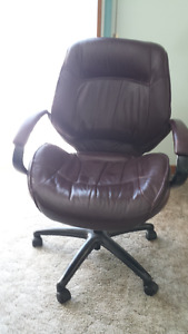 Two Swivel Chairs - Leather $50. Cloth $15.