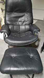 Leather swivel chair and ottoman