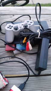 Ps2 with a controller and cords and 2 gateways