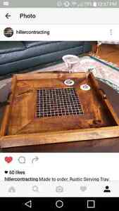 Wooden serving tray with mosaic center