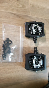 Shimano pedals (clipless or flats)