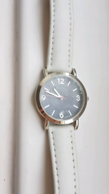 Face still sealed* White leather Watch