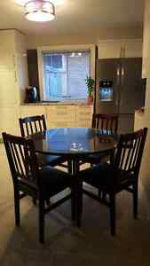 Dining set with glass top and 4 chairs