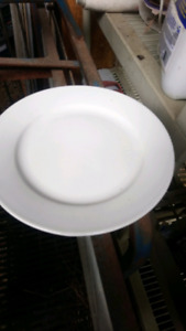 Cutlery, plates, soup bowls, condiments dishes
