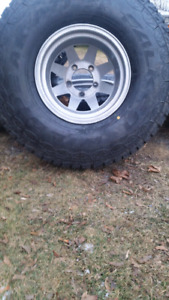 Four brand new 35x12.5R15 and aluminum rims