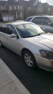 Nissan altima 2.5 sl runs good 230k.good on gas $2000 As Is