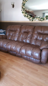 Leather couch and matching chair ..
