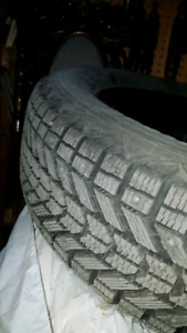 Almost new Firestone Winter Force studded tires for sale