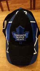 Multiple hats, mostly Toronto maple leafs