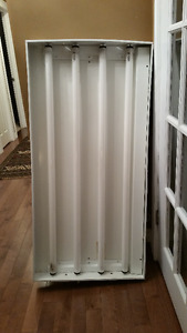 Four Glass Tube with fixture in good working condition.