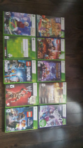 Xbox 360 with games and 2 controllers and kinect and lego dimens