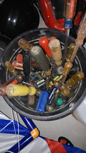 A bucket of screw drivers.