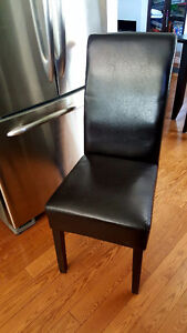 4 faux leather high back chairs in black with cherry legs