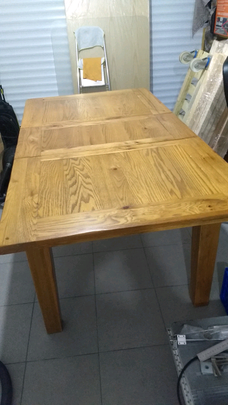 Heavy expandable oak dining table and 4 chair | in Dunmurry, Belfast | Gumtree