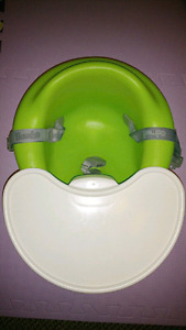 Bumbo chair with safety straps and tray