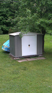 Green and White Metal Shed