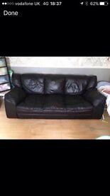 Large 3/4 seater black leather sofa
