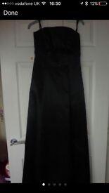 Brand new designer Debenhams dress ball gown. Black satin material.