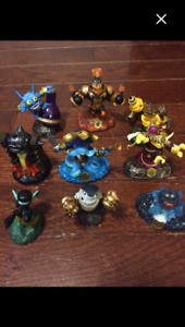 Skylanders figures, portals, PS3 games, and a storage bag