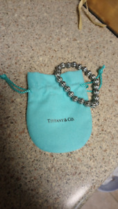 A Bracelet and a Tiffany & Co. pouch