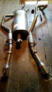 Stock exhaust system to a 2013 Dodge Ram sport St. John's Newfoundland image 1