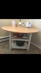 Round top Table with shelves underneath and 2 drop down leaves!