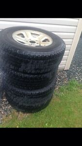 """16"""" Jeep rims and studded tires"""