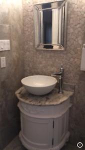 Bathroom vanity, sink, tap and two storage shelves