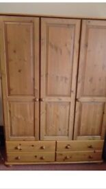 Pine triple wardrobe with 4 drawers underneath