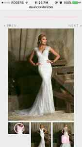 New wedding dress for sale.