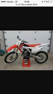 Crf 125 2014 only 3 tanks of gaz just like new 2600$neg