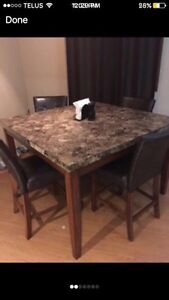 granite dining room table. With 4 chairs