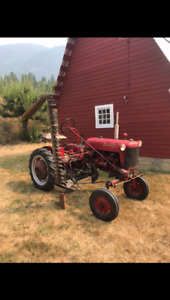 Farmall Tractor with snow plow, chains.