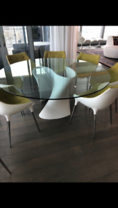 Designer glass dining table with 8 chairs