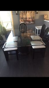Table and chairs and china cabinet