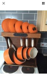 Le creuset pans and stand