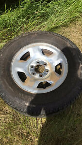 TWO SETS OF RIMS AND TIRES FORD AND GMC