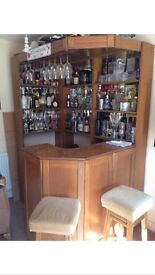 Home bar with stools and built in lights