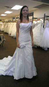 Never worn wedding dress for sale (never worn due to pregnancy)