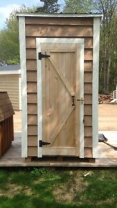 Solid wood outhouses
