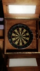 Dart board with cabnit.