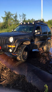 looking to buy back my old 2003 Jeep Liberty