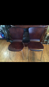 Pair of dark wooden form stacking chairs with metal frame