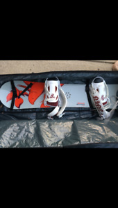 Ladies size 6 snow board and boots with carrying case euc