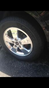 """4 Brand new 16"""" Michelin tires on alloy rims"""